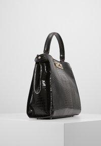 Guess - UPTOWN CHIC - Handbag - black - 4