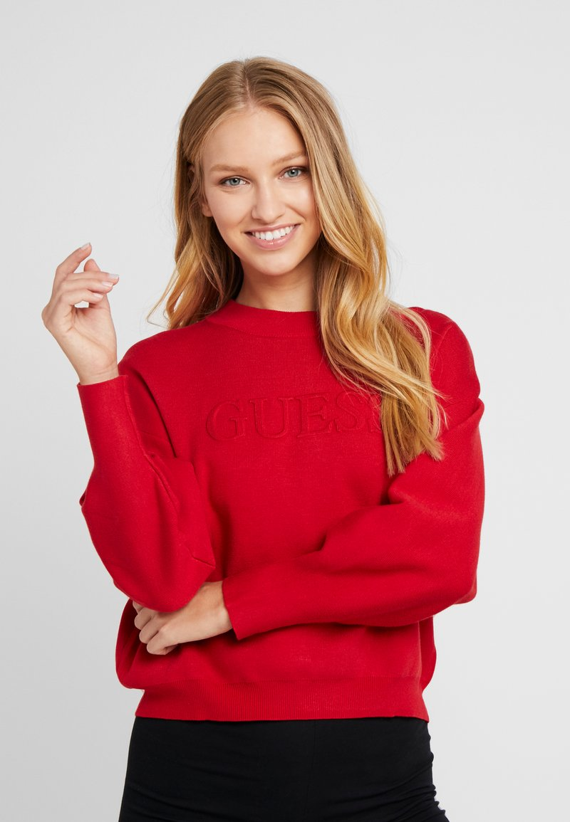 Guess - EMBOSSED LOGO SWEATER - Trui - planet red