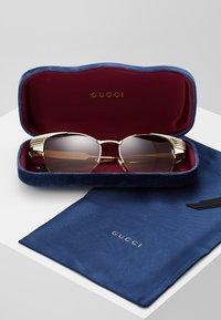 Gucci - Sluneční brýle - ivory/gold-coloured/brown - 2