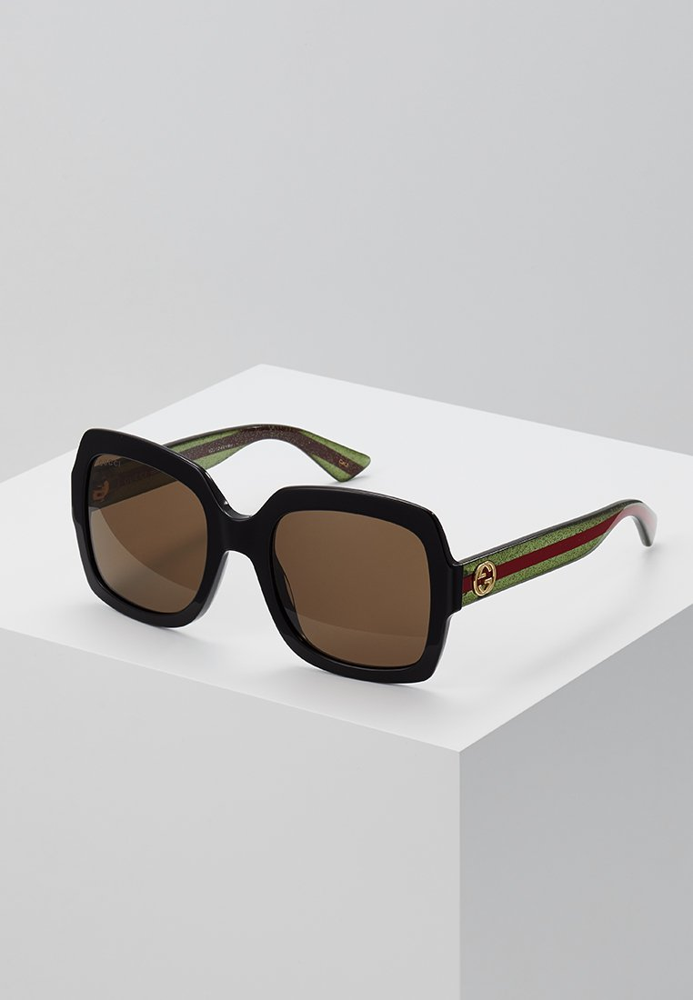 Gucci - Zonnebril - black/gree/brown