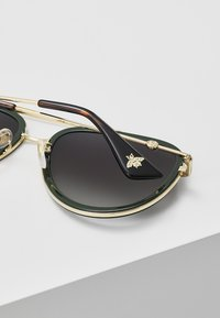 Gucci - Sunglasses - gold/green