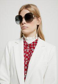 Gucci - Sonnenbrille - gold/grey - 1