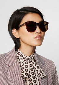 Gucci - Sonnenbrille - brown - 1
