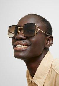 Gucci - Sonnenbrille - havana/gold - 1