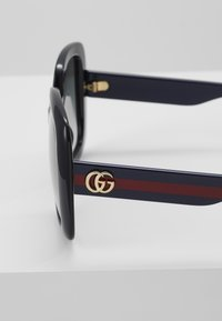 Gucci - Sunglasses - black/blue/grey