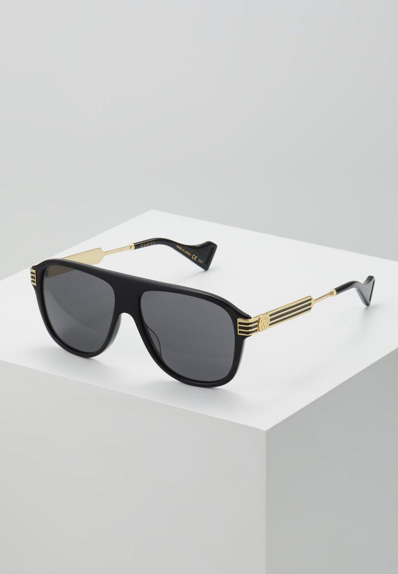 Gucci - Okulary przeciwsłoneczne - black/gold/grey