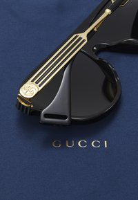 Gucci - Okulary przeciwsłoneczne - black/gold/grey - 4