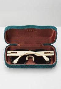 Gucci - Okulary przeciwsłoneczne - black/ivory/grey - 3