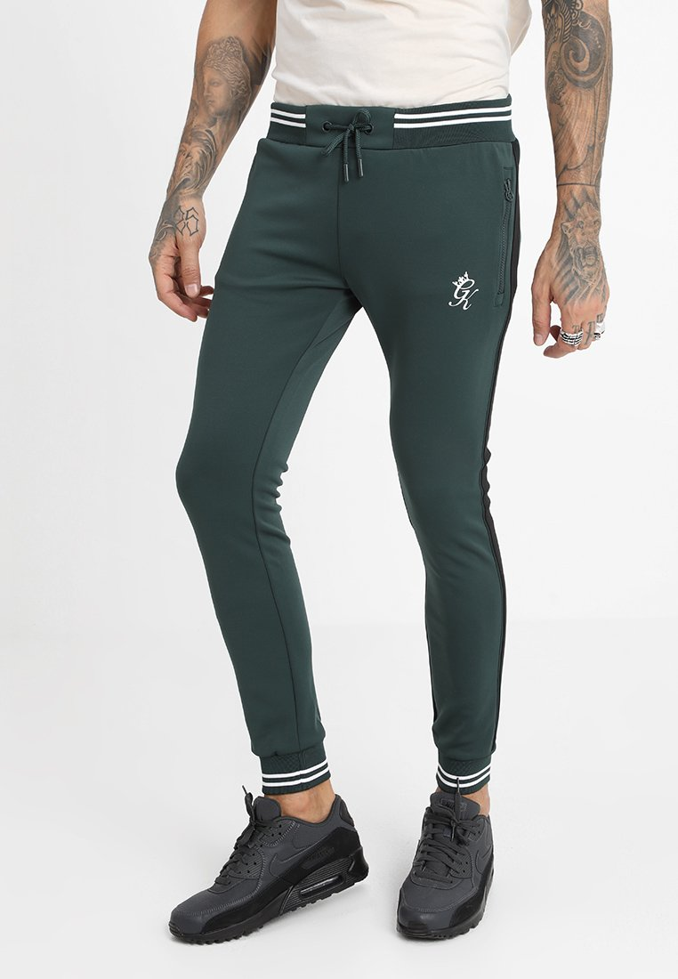Gym King - MAD DOG POLY PANT - Jogginghose - forest/white/black