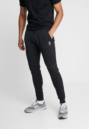 KHAN TRACKSUIT BOTTOMS - Pantalones deportivos - black