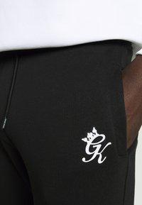 Gym King - BASIS - Spodnie treningowe - black - 3