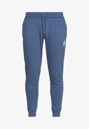 WITH PANEL OVERLAY - Tracksuit bottoms - bearing sea