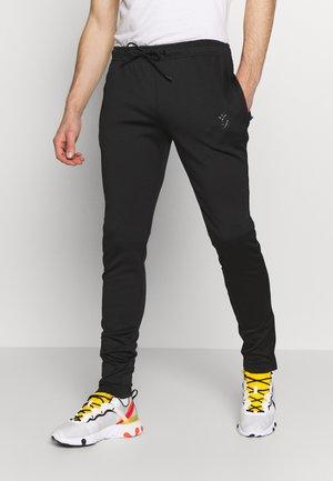 BASIS TRACKSUIT - Spodnie treningowe - black