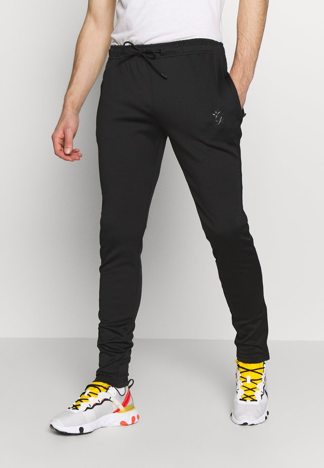 BASIS TRACKSUIT - Tracksuit bottoms - black