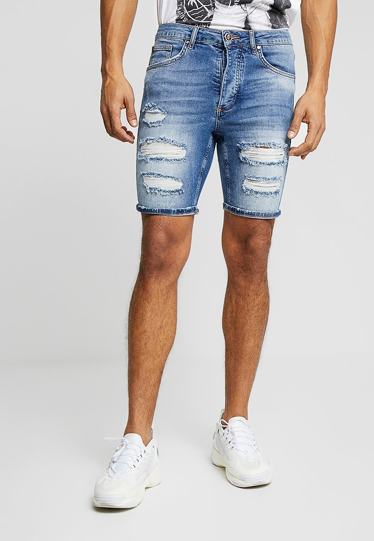 Gym King - DISTRESSED - Denim shorts - mid wash denim
