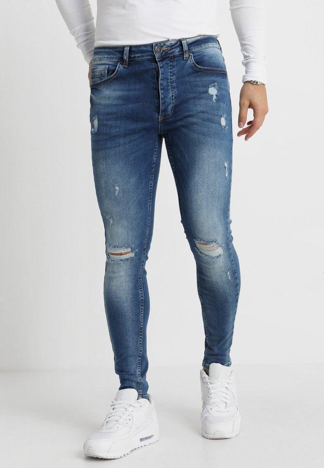 DISTRESSED - Skinny-Farkut - mid wash blue