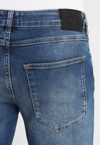 Gym King - DISTRESSED - Jeans Skinny - mid wash blue - 6