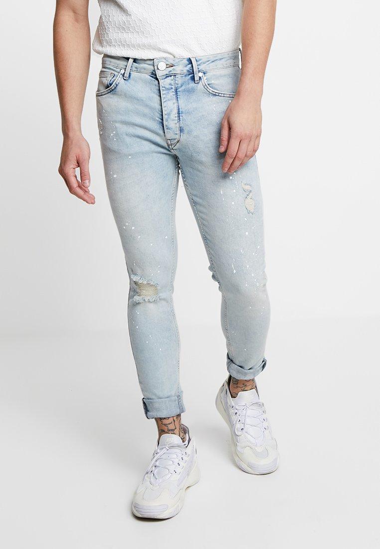 Gym King - DISTRESSED PAINT SPLATTER - Jeans Skinny Fit - light wash blue