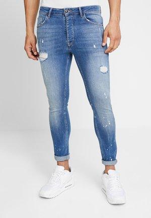 SALVATION PAINT SPLATTER - Jeans Skinny Fit - mid blue