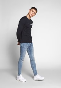 Gym King - WITH KNEE RIPS - Jeans Skinny Fit - light blue - 1