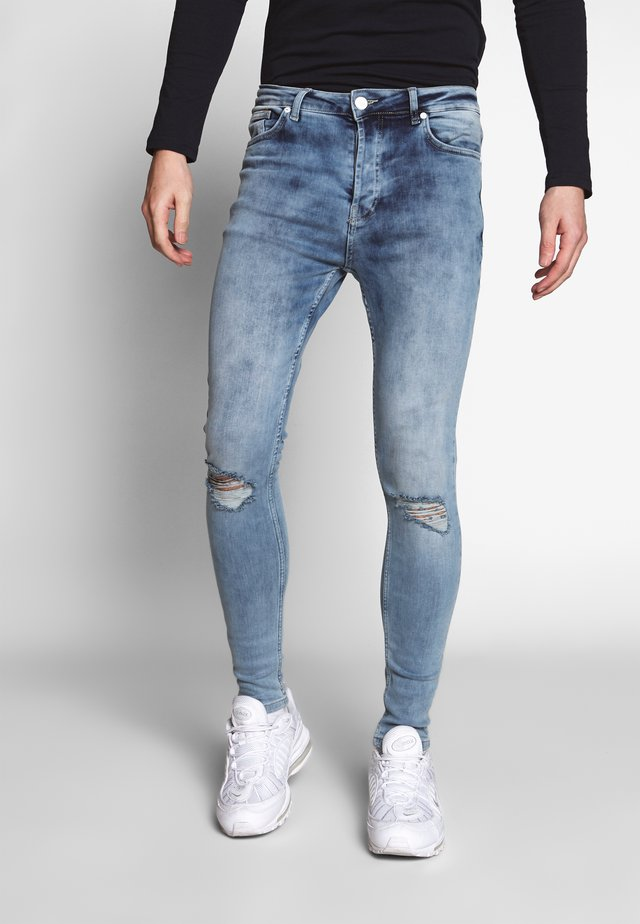 WITH KNEE RIPS - Jeans Skinny Fit - light blue