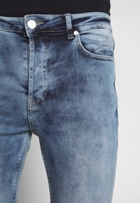 Gym King - WITH KNEE RIPS - Jeans Skinny Fit - light blue - 5