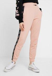 Hollister Co. - Pantalon de survêtement - pink - 0