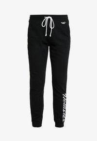 Hollister Co. - LOGO JOGGER - Pantalon de survêtement - black - 5