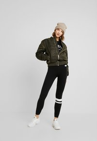 Hollister Co. - SPORTY LOGO FLEGGING - Legíny - black - 1
