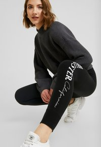 Hollister Co. - LOGO FLEGGING - Leggings - black - 4