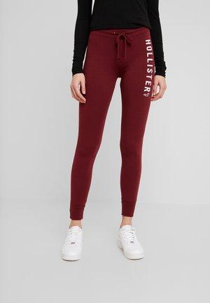 TIMELESS FLEGGING - Pantalones deportivos - bordeaux