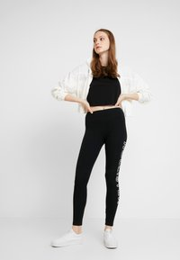 Hollister Co. - ROSE GRAPHIC - Leggings - Trousers - black - 1