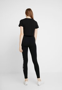 Hollister Co. - ROSE GRAPHIC - Leggings - Trousers - black - 2