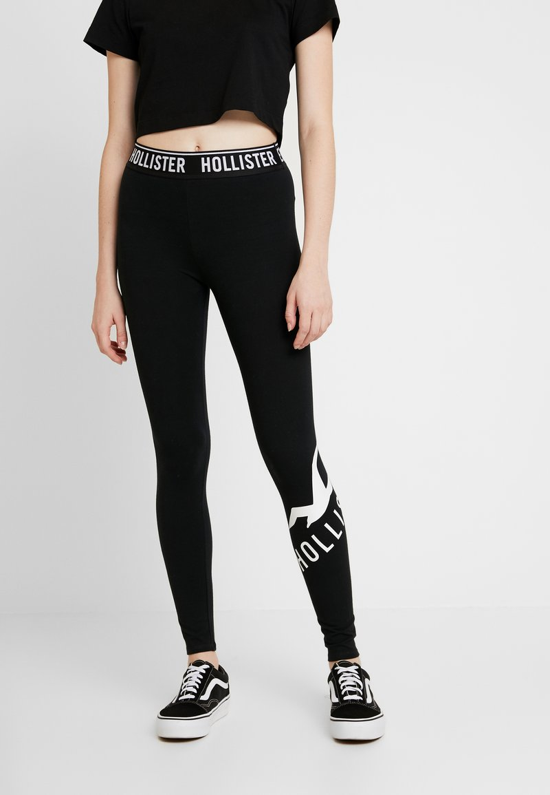 Hollister Co. - GRAPHIC - Leggings - Trousers - black