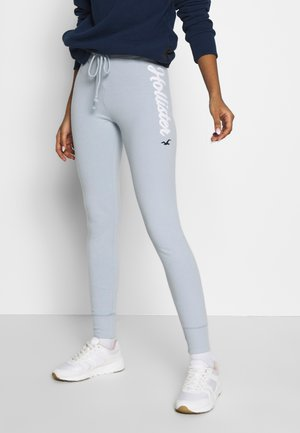LOGO FLEGGING - Tracksuit bottoms - light blue