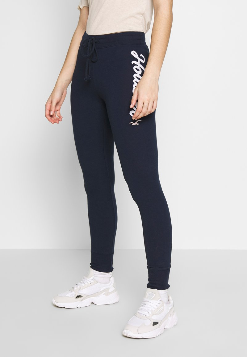 Hollister Co. - LOGO FLEGGING - Tracksuit bottoms - navy