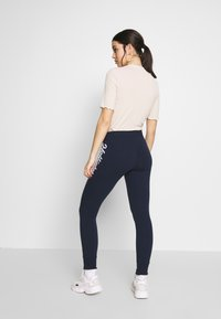 Hollister Co. - LOGO FLEGGING - Tracksuit bottoms - navy - 2