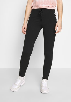 LOGO FLEGGING - Pantalon de survêtement - black