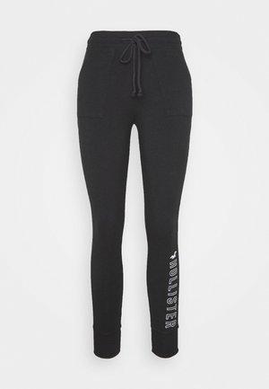 LOGO FLEGGING - Spodnie treningowe - black