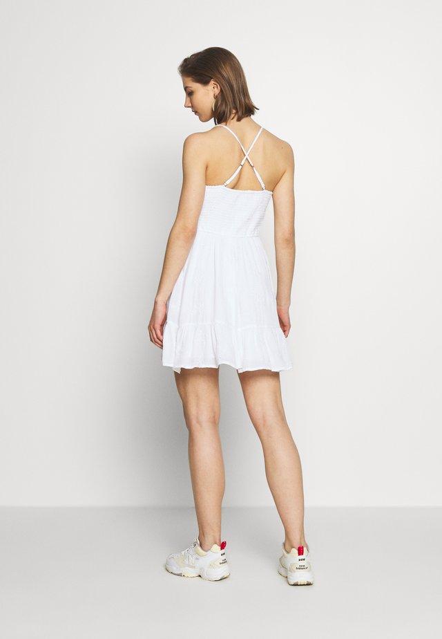 Korte jurk - white eyelet