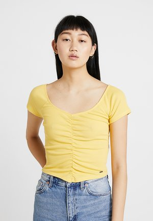 SLIM V NECK CINCH FRONT CROP - T-Shirt print - yellow