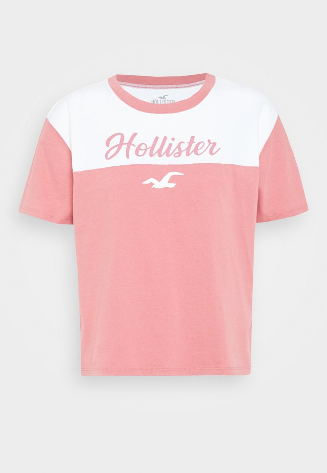 SPORTY - T-shirt med print - pink