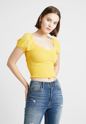 SMOCKED BODICE CROP - Bluse - yellow dobby