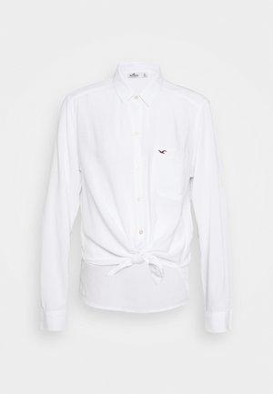 Button-down blouse - white texture