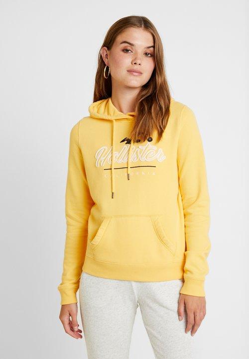 dobra jakość Hollister Co. CORE POPOVER - Bluza z kapturem - yellow Odzież Damska UJUN-CY8