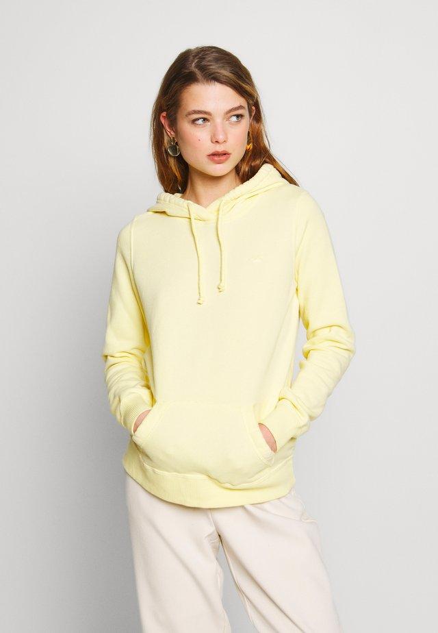 Luvtröja - mellow yellow