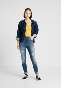 Hollister Co. - ULTRA HIGH RISE MEDIUM DESTROY  - Jeans Skinny Fit - dark-blue denim - 1