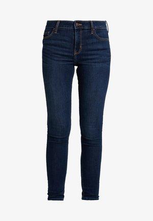 MEDIUM RISE SUPER - Jeans Skinny Fit - dark