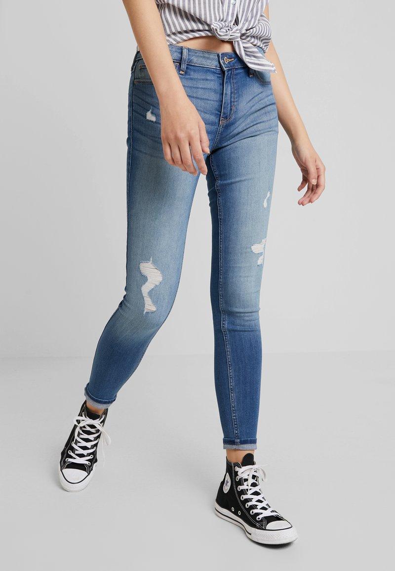Hollister Co. - MEDIUM RISE SUPER - Jeans Skinny Fit - blue denim