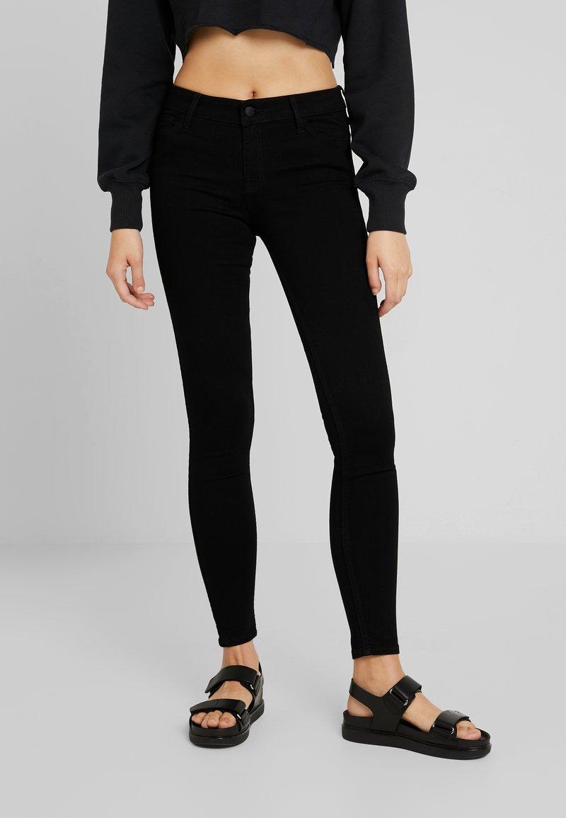 Hollister Co. - MEDIUM RISE SUPER  - Jeans Skinny Fit - black